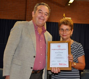 Helen Azzopardi receiving the Certificate
