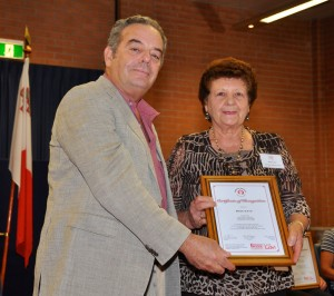 Rose Cato receiving the Certificate from Prof Stephen Gatt