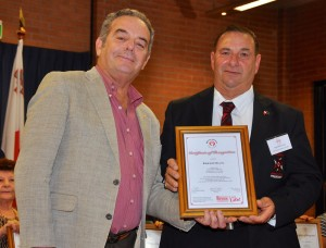 Edward Ellul receiving the Certificate