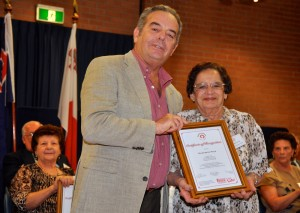 Elizabeth Pace receiving the Certificate