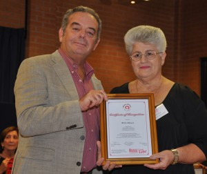 Rita Vella receiving the Certificat from Pof Stephen Gatt