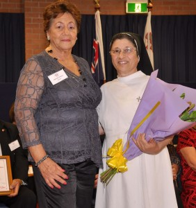 Marlene Dimech presents Sr Georgina with a bouquet of flowers in appreciation
